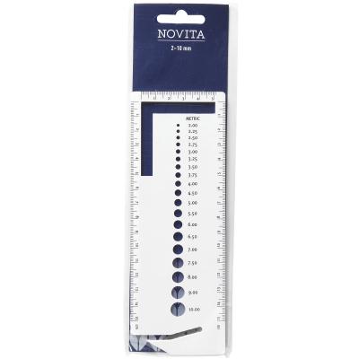 Novita knitter's gauge with yarn cutter